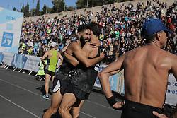 November 13, 2016 - Athens, Attica, Greece - Runners celebrate having just crossed the finish line of the 34th Athens Classic Marathon, at the Panathenaic stadium in Athens, Greece, on Sunday November 13, 2016. (Credit Image: © Panayiotis Tzamaros/NurPhoto via ZUMA Press)