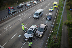 © Licensed to London News Pictures . 25/10/2016 . Salford , UK . Fatal crash scene on the westbound carriageway of the A580 East Lancs Road at the junction with Moorside Road in Salford , where a man in his 70s died following a collision involving two Nisson Primeras and another vehicle , this morning (Tuesday 25th October 2016) .  Photo credit : Joel Goodman/LNP