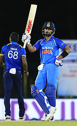 August 20, 2017 - Dambulla, Sri Lanka - Indian captain Virat Kohli celebrates after scoring 50 runs during the 1st One Day International cricket match bewtween Sri Lanka and India at Dambulla International cricket stadium situated in the Central Province and the first and only International cricket ground in the dry zone of Sri Lanka on Sunday 20 August 2017. (Credit Image: © Tharaka Basnayaka/NurPhoto via ZUMA Press)