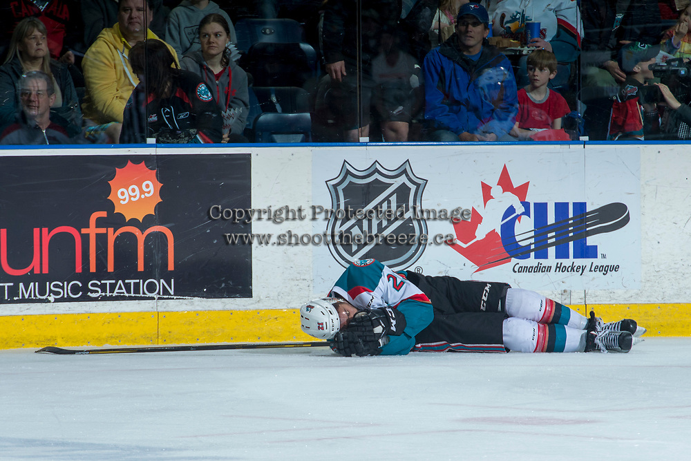 KELOWNA, CANADA - APRIL 30: Devante Stephens #21 of the Kelowna Rockets lies on the ice after a check from behind by Keegan Kolesar #28 of the Seattle Thunderbirds on April 30, 2017 at Prospera Place in Kelowna, British Columbia, Canada.  (Photo by Marissa Baecker/Shoot the Breeze)  *** Local Caption ***