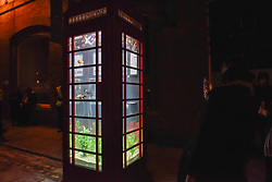 "© Licensed to London News Pictures. 18/01/2018. LONDON, UK. ""Aquarium"" by Benedetto Bufalino & Benoit Deseille.  A BT phone box has been converted into an aquarium with live goldfish in Earlham Street, Seven Dials.  Opening night of Lumiere London, the capital's largest arts festival commissioned by The Mayor of London and produced by Artichoke.  Light installations by leading artists have been set up, both north and south of the river for the public to view 18-21 January. Photo credit: Stephen Chung/LNP"