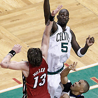 07 June 2012: Boston Celtics power forward Kevin Garnett (5) gets the jump ball over Miami Heat shooting guard Mike Miller (13) during first half of Game 6 of the Eastern Conference Finals playoff series, Heat at Celtics at the TD Banknorth Garden, Boston, Massachusetts, USA.