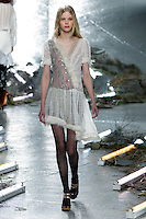 Amalie Schmidt walks the runway wearing Rodarte Fall 2015 during Mercedes-Benz Fashion Week in New York on February 17, 2015