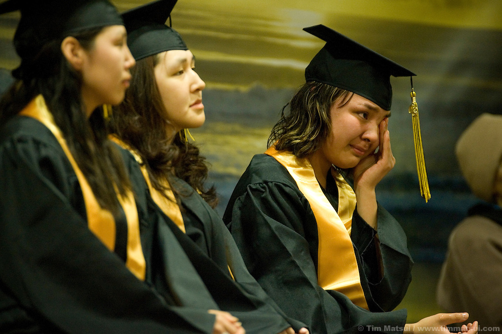 May 2, 2008 -- Kivalina, AK, U.S.A..High school graduates, from left to right, Kandes Sage, Loni Frankson, and Sonja Barger, in the native village of Kivalina, Alaska. Kivalina is suing 20 oil companies for property damage related to global warming; the ocean pack ice forms later and melts earlier, leaving the town vulnerable to erosive winter storms and endangering their traditional subsistence lifestyle. (Photo by Tim Matsui)