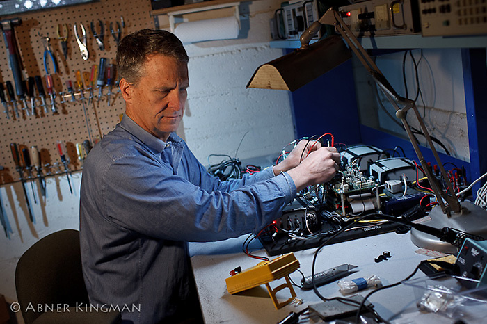 Stan Honey in his basement workshop at  home in Palo Alto, CA, working on boat tracking equipment he is developing for America's Cup 34.