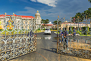 18 MAY 2014 - BANGKOK, THAILAND: People's Democratic Reform Committee (PDRC) guards close the gates to Government House after admitting anti-government leaders. Suthep Thaugsuban called representatives state enterprises to a meeting at his office in Government House, normally the office of the Prime Minister, to make assignments for the coming week. Suthep has pledged to overthrow the government of interim caretaker Prime Minister Niwatthamrong Boonsongphaisan, a member of former Prime Minister Yingluck Shinawatra's inner circle. Niwatthamrong became PM after the courts ousted Yingluck. Suthep has pledged to remove the Shinawatra family from Thai politics by May 27 or he will turn himself into police to face prosecution.      PHOTO BY JACK KURTZ