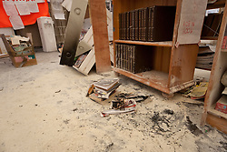 © licensed to London News Pictures. London, UK 11/02/2012. An arson attack leaves significant damage to Occupy London St Paul Camp's Library Tent at approximately 6.50am this morning. Photo credit: Tolga Akmen/LNP
