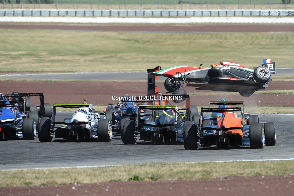 Brandon Maisano from France escaped unscathed as his TRS car flips during the feature race at Taupo on Sunday 8 Feb 2015.
