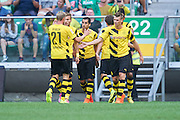 (R) Lukasz Piszczek of Dorussia Dortmund celebrates with team mates after goal for Borussia during international friendly soccer match between WKS Slask Wroclaw and BVB Borussia Dortmund on Municipal Stadium in Wroclaw, Poland.<br /> <br /> Poland, Wroclaw, August 6, 2014<br /> <br /> Picture also available in RAW (NEF) or TIFF format on special request.<br /> <br /> For editorial use only. Any commercial or promotional use requires permission.<br /> <br /> Mandatory credit:<br /> Photo by &copy; Adam Nurkiewicz / Mediasport