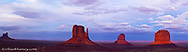 The Mittens and Merrick Buttes at sunset in Monument Valley Navajo Tribal Park on the Arizona and Utah state line