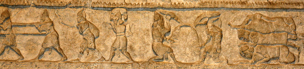 Assyrian palace decoration. Carved reliefs in walls that would have originally been in the interior of a palace. Depicting hunting, battle and religious scenes.