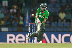 © Licensed to London News Pictures. 25/09/2012. Bangladesh batsmen Shakib Al Hasan plays an unorthodox shot while batting during the T20 Cricket World T20 match between Pakistan Vs Bangladesh at the Pallekele International Stadium Cricket Stadium, Pallekele. Photo credit : Asanka Brendon Ratnayake/LNP