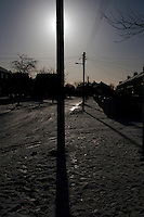 Snow covered roads and winter sunlight in suburban in Dublin Ireland