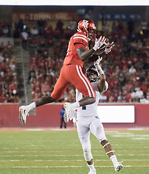 September 16, 2017 - Houston, TX, USA - Houston Cougars wide receiver Courtney Lark (9) leaps to make a catch over the defense of Rice Owls cornerback Justin Bickham (7) during the third quarter of the college football game between the Houston Cougars and the Rice Owls at TDECU Stadium in Houston, Texas. (Credit Image: © Scott W. Coleman via ZUMA Wire)