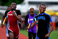 8 MAY 2010 -- COLLINSVILLE, Ill. -- Cahokia High School runner Ly'Jerrick Ward (right, CQ) reaches the finish line during the 4x400-meter relay at the Collinsville Invitational at Collinsville High School Saturday, May 8, 2010. Photo © copyright 2010 by Sid Hastings.
