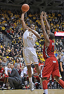 WICHITA, KS - NOVEMBER 12:  Forward Darius Carter #12 of the Wichita State Shockers puts up a shot over forward George Fant #44 of the Western Kentucky Hilltoppers during the first half on November 12, 2013 at Charles Koch Arena in Wichita, Kansas.  (Photo by Peter Aiken/Getty Images) *** Local Caption *** Darius Carter;George Fant