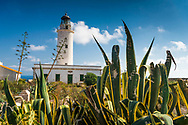 Formentera, Spain, October 2017. Faro de la Mola or Far de Formentera lighthouse. Formentera is the smallest of Spain's Balearic islands in the Mediterranean Sea. It's reachable by ferry from its more crowded, better known island neighbor, Ibiza, and makes for a popular day-trip destination in the summertime. It's known for its clear waters and long stretches of beach backed by dunes and pine trees. Pastimes include snorkeling and sailing, with equipment rentals and boat charters available. Photo by Frits Meyst / MeystPhoto.com