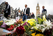 UNITED KINGDOM, London: 17 June 2016 People stop lay flowers and pay there respects at a floral tribute outside Parliament for murdered MP Jo Cox. The Labour MP for West Yorkshire was murdered yesterday in her constituency. Pic by Andrew Cowie / Story Picture Agency