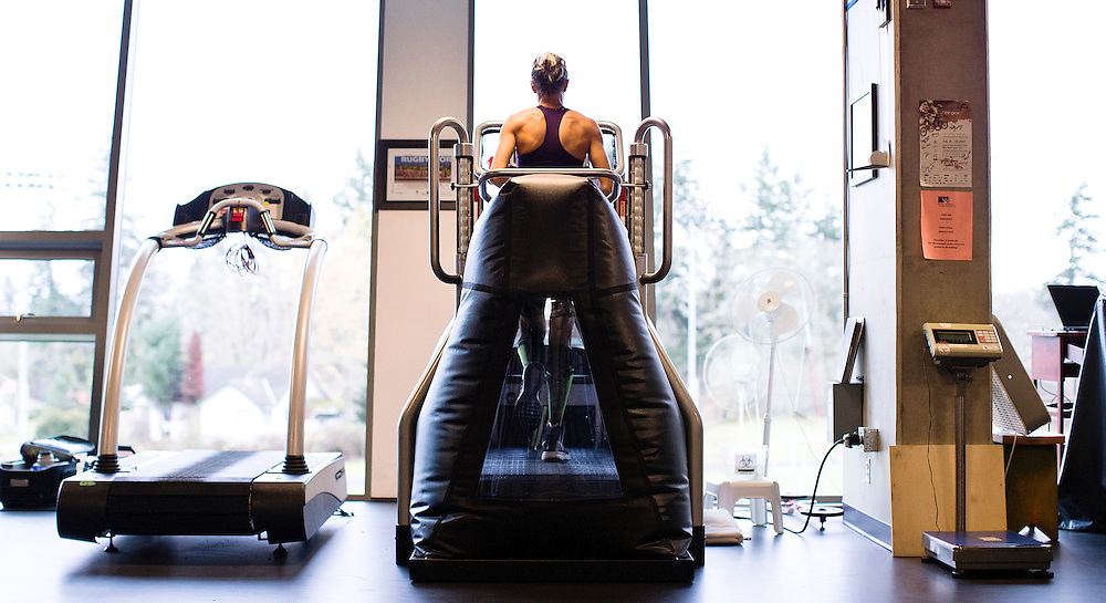 Melissa Bishop trains on an anti gravity treadmill called ultra G which lifts the body weight off the athlete so there is not as much pounding on the joints and muscles at the PISE Pacific Institute for Sport Excellence on December 3rd, 2015 in Victoria, British Columbia Canada.<br /> <br /> This is good for recovery and coming back from injury like stress fractures, tendons or knees.