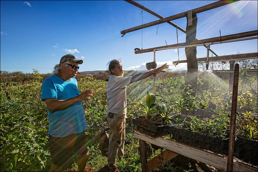 Homestead farmer Bobby Alcain shows Brother Nolan his irrigation system at his 'Aina Pulapula Farm on Molokai.