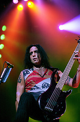 Marco Mendoza - Bass Guitarist with Whitesnake on stage headlining the  Monsters of Rock show at Hallam FM Arena Sheffield <br /> Marco Mendoza (born May 3, 1963) is an American rock musician. He has played bass guitarist with the likes of Thin Lizzy, Whitesnake and The Dead Daisys<br /> 21 May 2003<br /> <br /> Image Copyright Paul David Drabble
