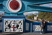Tourists stop to take a selfie by one of Tower Bridge's giant Victorian-designed suspension chains. The bridge is undergoing repairs, closed to traffic and disrupting this major Thames crossing and surrounding roads for the next three months.