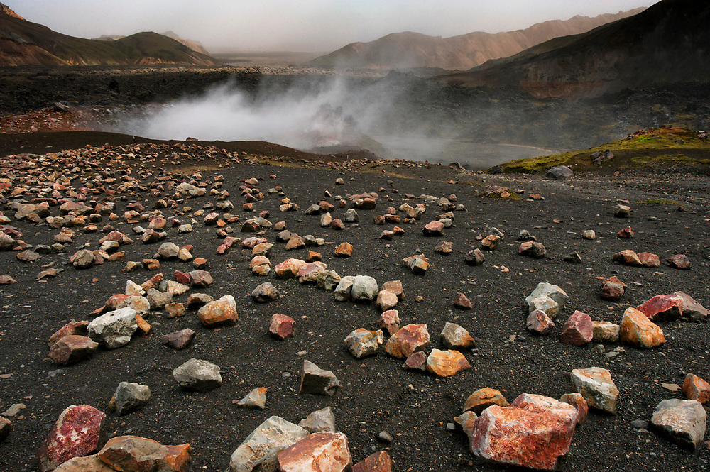 A steaming hole smelling of sulphur vents from the grounds at Landmannalaugar, Iceland