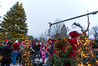 Santa and Mrs. Claus light up the tree at Veteran's Square following the Light Up Laconia Holiday parade on Sunday afternoon.  (Karen Bobotas/for the Laconia Daily Sun)