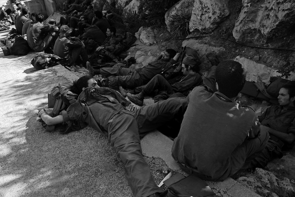 Israeli soldiers rest in the shade, close to the town of Metulla after an operation in Lebanon. Aug 2006