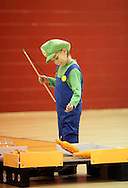 Middletown, New York  - A boys wearing a costume plays a game in the gymnasium during the Middletown YMCA Family Fall Festival on Oct. 29, 2011.