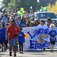 Parents ad students from Lawndale Elementary School walk in the Tupelo High School Homecoming Parade Thursday in Tupelo.