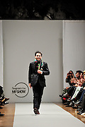 Spanish fashion designer Jorge Acuña greeting on the runway