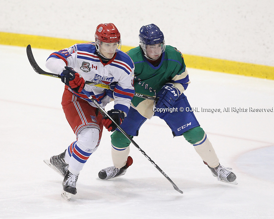 OAKVILLE, ON  - JAN 6,  2017: Ontario Junior Hockey League game between the Oakville Blades and the Burlington Cougars, Jaxon Camp #23 of the Burlington Cougars and Bryce Misley #18 of the Oakville Blades battle for position during the second period.<br /> (Photo by Tim Bates / OJHL Images)