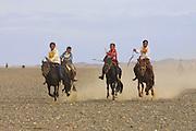 GOBI DESERT, MONGOLIA..08/26/2001.Bayangovi. Local Naadam festival. Finish of the runners-up in a horse race over 30 kilometers..(Photo by Heimo Aga).
