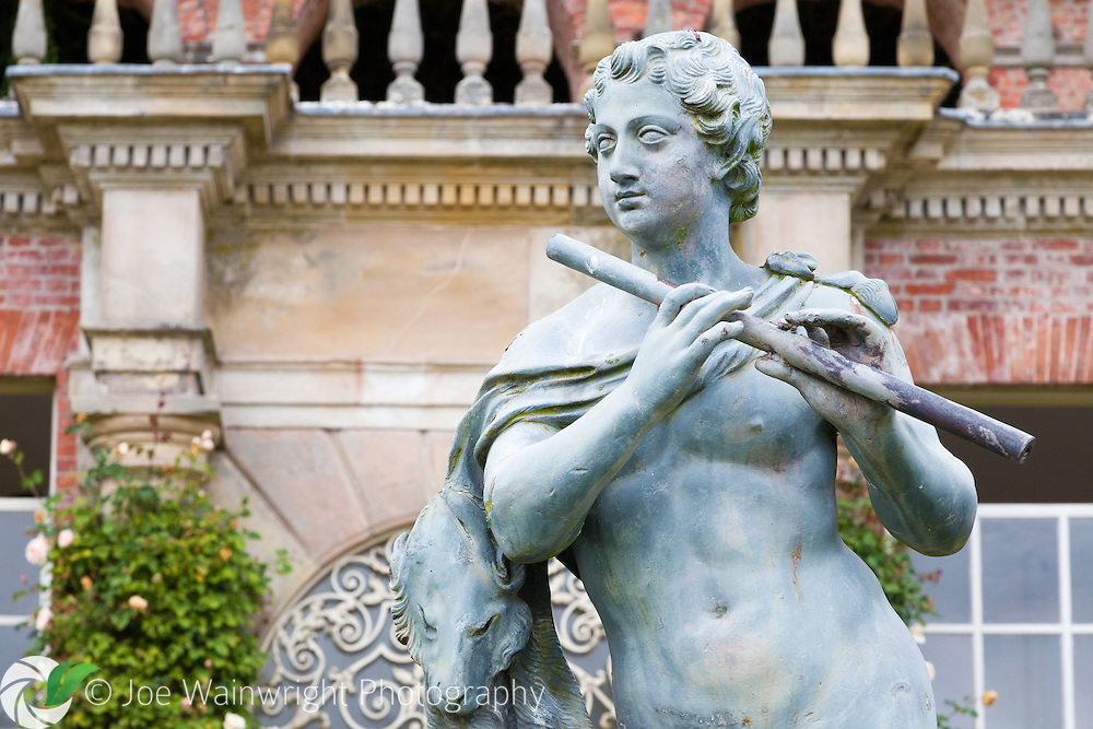 The statue of a flute player on the Orangery terrace at Powis Castle, Welshpool, Powys, photographed in September