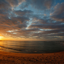 The sun sets over Head of the Meadow Beach at the Cape Cod National Seashore in Truro, Massachusetts.