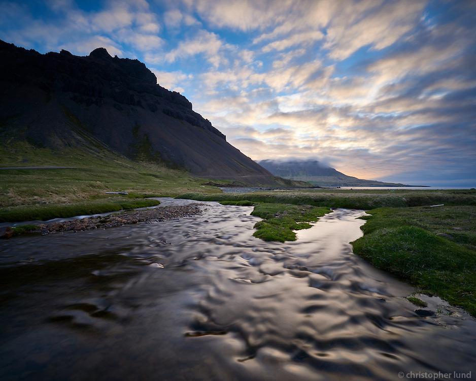 River Melaá running into Norðurfjörður at daybreak. Mount Urðartindur left. Strandir Northwest Iceland.