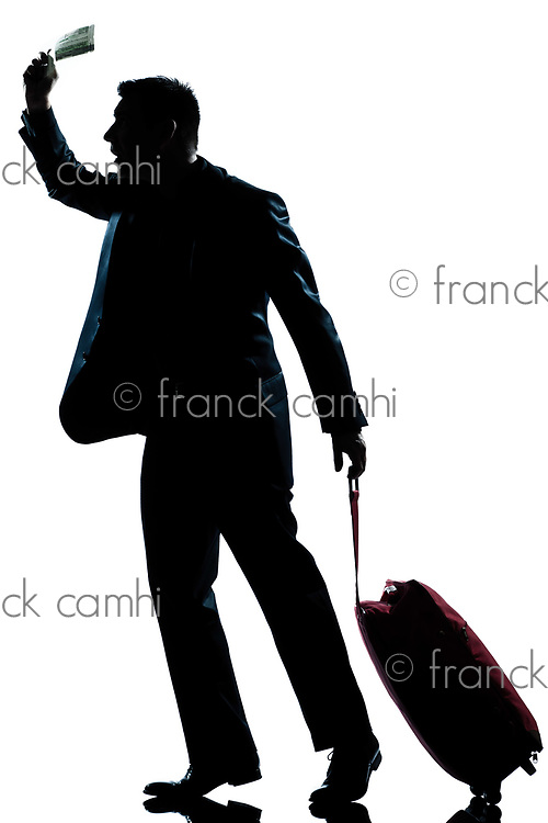 one caucasian business traveler man walking with suitcase hurrying late  full length silhouette in studio isolated white background