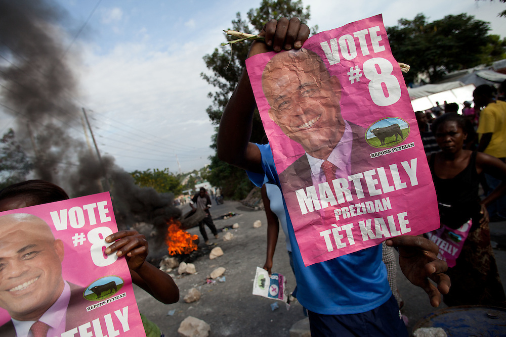 Protesters, many of whom are supporters of Michel Martelly, take to the streets in protest after the results of the January 28th election were announced last night.