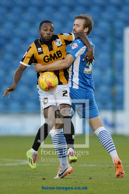 Mark Marshall of Port Vale does battle with David Fox of Colchester United during the Sky Bet League 1 match between Colchester United and Port Vale at the Weston Homes Community Stadium, Colchester<br /> Picture by Richard Blaxall/Focus Images Ltd +44 7853 364624<br /> 01/11/2014