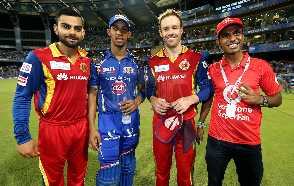 Royal Challengers Bangalore captain Virat Kohli , Mumbai Indians player Lendl Simmons, Royal Challengers Bangalore player AB De Villiers and vodafone fan pose for the pix during the presentation of the match 46 of the Pepsi IPL 2015 (Indian Premier League) between The Mumbai Indians and The Royal Challengers Bangalore held at the Wankhede Stadium in Mumbai, India on the 10th May 2015.<br /> <br /> Photo by:  Sandeep Shetty / SPORTZPICS / IPL