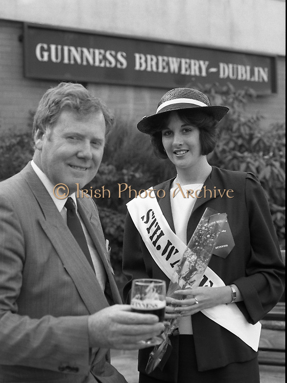 Roses of Tralee at Guinness Brewery..1986.20.08.1986..08.20.1986..20th August 1986..As part of the 50th running of the Rose Of Tralee Festival the thirty Rose contestants were invited to The Guinness Brewery,St James's Gate,Dublin. At the reception in their honour, Mr Pat Healy,Sales Director,Guinness Group Sales,welcomed the roses at the Guinness Reception Centre..Extra: Ms Noreen Cassidy,representing Leeds,went on to win the title of 'Rose Of Tralee'...The South Wales Rose, pictured at the reception with Mr Brian Brown,Guinness Group Sales.