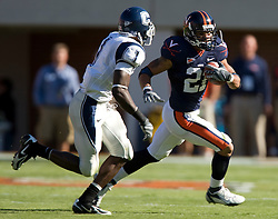 Virginia wide receiver Andrew Pearman (21) rushes around Connecticut cornerback Darius Butler (1)..The Virginia Cavaliers defeated the Connecticut Huskies 17-16 at Scott Stadium in Charlottesville, VA on October 13, 2007