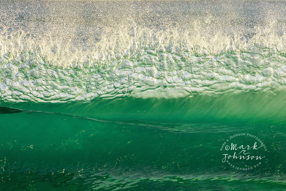 Beautiful Wave breaking off a beach in Oahu, Hawaii