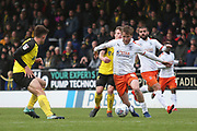 Burton Albion  (8) is shadowed by Burton Albion midfielder Jamie Allen (4) during the EFL Sky Bet League 1 match between Burton Albion and Luton Town at the Pirelli Stadium, Burton upon Trent, England on 27 April 2019.