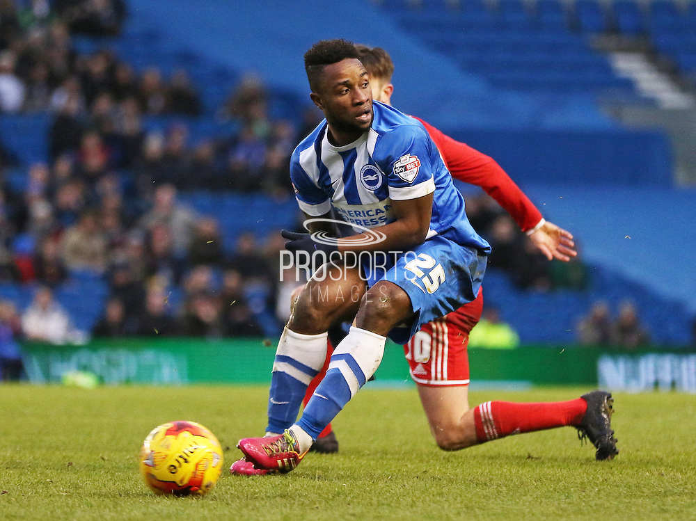 Brighton's Kazenga LuaLua on the ball during the Sky Bet Championship match between Brighton and Hove Albion and Nottingham Forest at the American Express Community Stadium, Brighton and Hove, England on 7 February 2015. Photo by Phil Duncan.