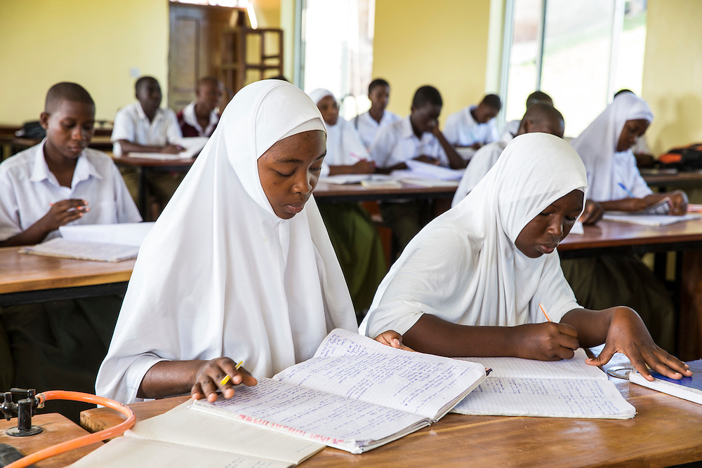 Children studying during a class taken by VSO volunteer Paul Jennings and local teacher Rebecca  Ngovano. Paul has been working with Rebecca for over 6 months to improve teaching methodologies in classrooms. Angaza school, Lindi, Tanzania
