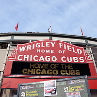 Wrigley Field sign and Chicago Cubs souvenir sign. Wrigley Field was built in 1914 and is also referred to as The Friendly Confines. High resolution prints and stock photos are available.