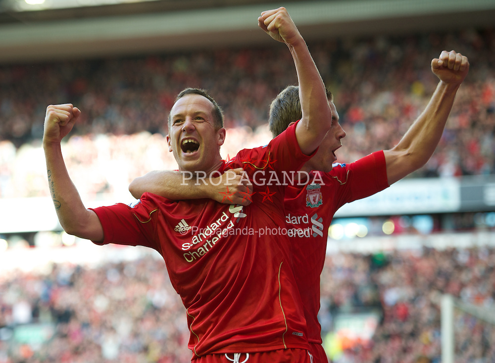 LIVERPOOL, ENGLAND - Saturday, August 27, 2011: Liverpool's Charlie Adam celebrates scoring the third goal against Bolton Wanderers with team-mate Jordan Henderson during the Premiership match at Anfield. (Pic by David Rawcliffe/Propaganda)