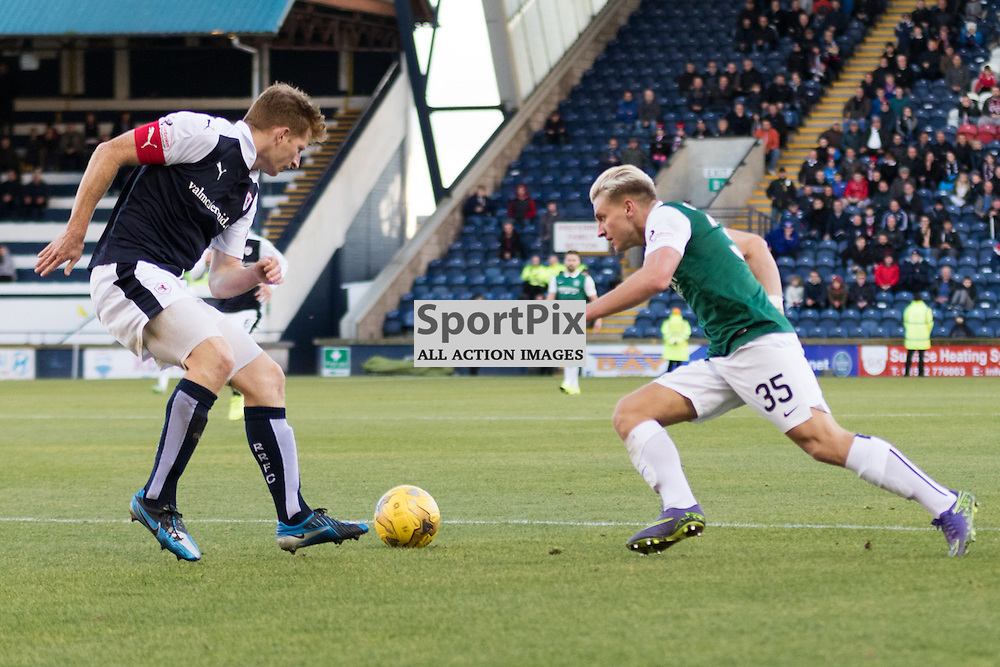Raith Rovers's Jason Thomson looks on as Hibernian's Jason Cummings takes the ball past him in the Raith Rovers vs Hibernian Scottish Championship 24th October 2015......(c) MARK INGRAM | SportPix.org.uk